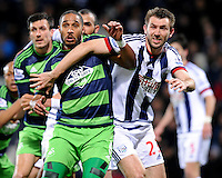 Ashley Williams of Swansea City battles with  Gareth McAuley of West Bromwich Albion at a corner during the Barclays Premier League match between West Bromwich Albion and Swansea City at The Hawthorns on the 2nd of February 2016