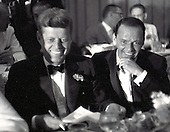 "United States Senator John F. Kennedy (Democrat of Massachusetts), left, and entertainer Frank Sinatra, right, at the black tie Democratic Committee Dinner at the Beverly Hilton Hotel in Los Angeles, California on Sunday, July 10, 1960.<br /> Credit: Benjamin E. ""Gene"" Forte / CNP"