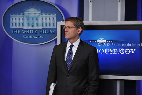 White House Press Secretary Jay Carney looks on as United States Secretary of Transportation Ray LaHood speaks to the media prior to conducting his daily briefing in the Brady Briefing Room at the White House in Washington, D.C. on Thursday, July 28, 2011..Credit: Ron Sachs / Pool via CNP