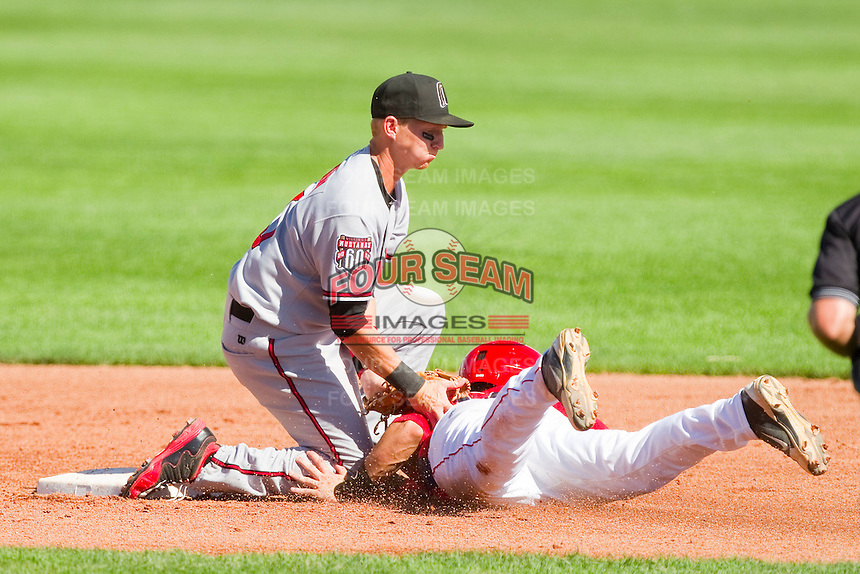 Taylor Wrenn (5) of the Billings Mustangs puts the tag on Joel Capote (17) of the Orem Owlz as he tries to steal second base at Brent Brown Ballpark on July 22, 2012 in Orem, Utah.  The Mustangs defeated the Owlz 13-8.  (Brian Westerholt/Four Seam Images)