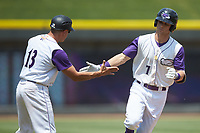 Zach Remillard (7) of the Winston-Salem Dash slaps hands with third base coach Omar Vizquel (13) after hitting a home run against the Buies Creek Astros at BB&T Ballpark on July 15, 2018 in Winston-Salem, North Carolina. The Dash defeated the Astros 6-4. (Brian Westerholt/Four Seam Images)