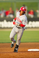 Khayyan Norfork (6) of the Hagerstown Suns rounds the bases after hitting a home run against the Kannapolis Intimidators at CMC-Northeast Stadium on May 17, 2013 in Kannapolis, North Carolina.  The Suns defeated the Intimidators 9-7.   (Brian Westerholt/Four Seam Images)