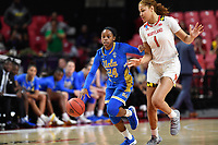 College Park, MD - March 25, 2019: UCLA Bruins guard Japreece Dean (24) dribbles around Maryland Terrapins forward Shakira Austin (1) during second round game of NCAAW Tournament between UCLA and Maryland at Xfinity Center in College Park, MD. UCLA advanced to the Sweet 16 defeating Maryland 85-80.(Photo by Phil Peters/Media Images International)