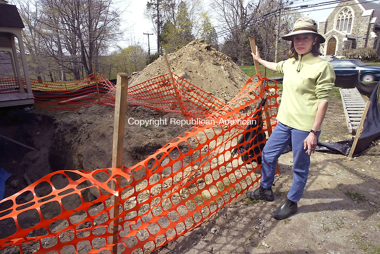 WASHINGTON, CT -21 APRIL 2006 -042106JT04--<br /> Ann Khouri stands next to her house on Green Hill Road Friday, April 21, which is being repaired after a a car crashed into it in June.<br /> Josalee Thrift Republican-American