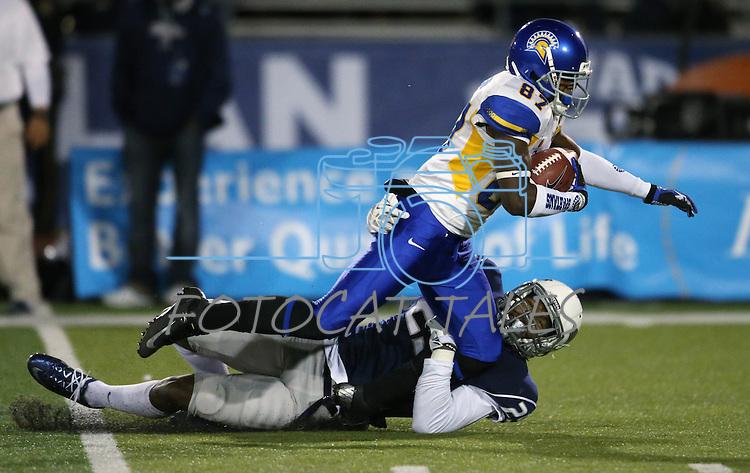 Nevada's Bryan Lane Jr. tackles San Jose State's Hansell Wilson in an NCAA college football game in Reno, Nev., on Saturday, Nov. 16, 2013. (AP Photo/Cathleen Allison)