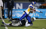 Nevada's Bryan Lane Jr. tackles San Jose State's Hansell Wilson in an NCAA college football game in Reno, Nev., on Saturday, Nov. 16, 2013. (AP Photo/Cathleen Allison)