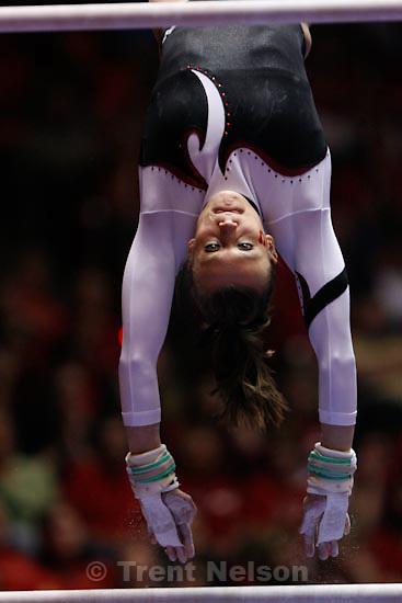 Trent Nelson  |  The Salt Lake Tribune.Salt Lake City - Utah's Daria Bijak on the bars, Utah vs. BYU college gymnastics Friday, March 26, 2010.