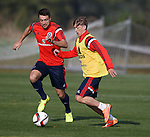 Ryan Gauld runs with the ball as Russell Martin challenges