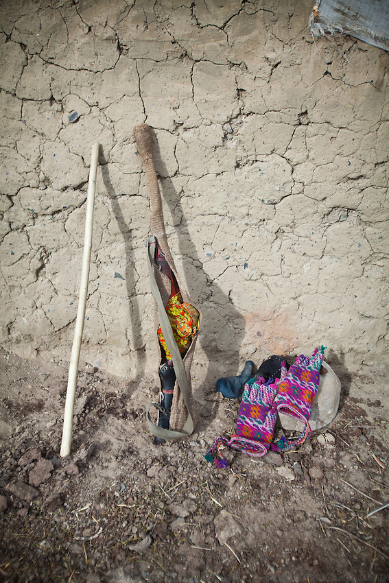 """Wakhi stick (named """"Asoy""""), gun called Muchkuch (means """" mouse killer"""") and colorful Wakhi gloves...Trekking up the Wakhan frozen river, the only way up to reach the high altitude Little Pamir plateau, home of the Afghan Kyrgyz community."""