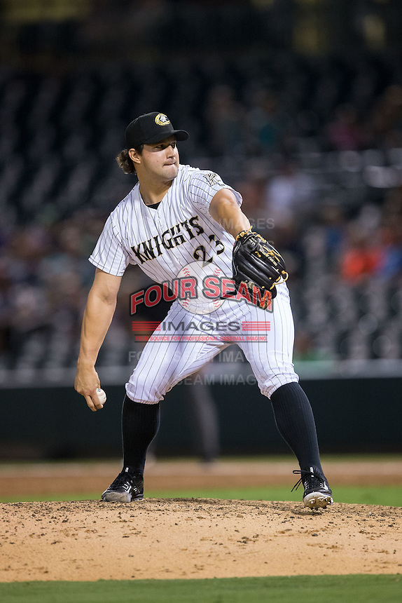 Charlotte Knights relief pitcher Tommy Kahnle (23) in action against the Pawtucket Red Sox at BB&T BallPark on July 6, 2016 in Charlotte, North Carolina.  The Knights defeated the Red Sox 8-6.  (Brian Westerholt/Four Seam Images)