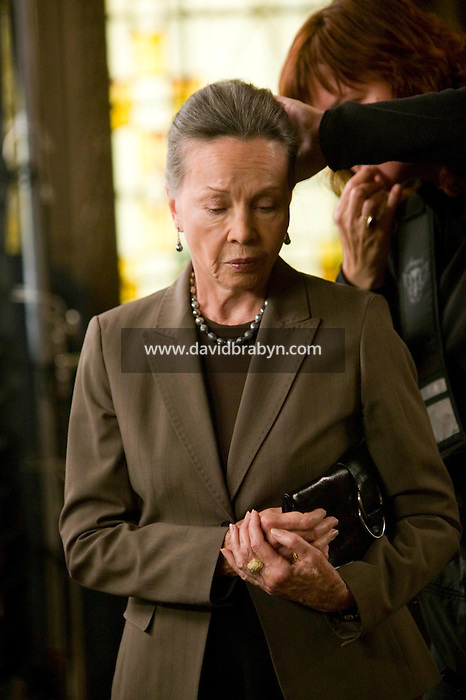 """8 May 2006 - North Bergen, NJ - French actress Leslie Caron (L) gets her hair retouched on the studio set of television show """"Law & Order: SVU"""" in North Bergen, USA, 8 May 2006. In this rare appearance in front of American television cameras, Caron, 74, plays a French victim of past sexual molestation in an episode entitled """"Recall"""" due to air in the fall. Caron starred in Hollywood classics such as """"An American in Paris"""" (1951), """"Lili"""" (1953), """"Gigi"""" (1958). More recently she appeared in """"Chocolat"""" (2000) and """"Le Divorce"""" (2003). Photo Credit: David Brabyn"""