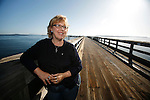 Leader of the Green Party, Elizabeth May, stands on a pier in Sidney, British Columbia, BC. May has moved to Sidney and will seek nomination in the Saanich-Gulf Islands riding. Photo assignment for the National Post national newspaper in Canada.