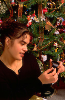 Tongan American age 18 looking at Christmas gift of a gold ring. St Paul Minnesota USA