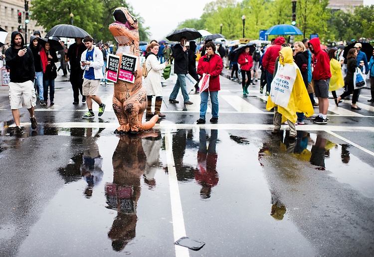 UNITED STATES - APRIL 22: Marchers, including a couple in T-Rex dinosaur costumes, gather for the March for Science down Constitution Avenue in Washington on Earth Day, Saturday, April 22, 2017. Thousands of pro-science and environmental activists rallied on the National Mall before marching towards the Capitol. (Photo By Bill Clark/CQ Roll Call)