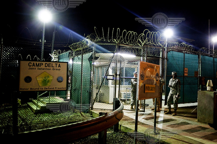 Entrance to Camp Delta at the American naval base at Guantanamo Bay, where over 600 alleged al Qaeda members have been held indefinitely. Described by the US as 'unlawful enemy combatants', they were captured primarily in Afghanistan during the 'war against terror'.