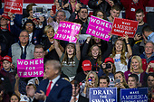 Supporters hold campaign signs a United States President Donald J. Trump speaks during a Make America Great Again campaign rally at Atlantic Aviation in Moon Township, Pennsylvania on March 10th, 2018. Credit: Alex Edelman / CNP