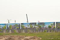 Daytime landscape view of city development signage at the Sino-Singapore Tianjin Eco-city near the Binhai New Area Tanggu District in Tiānjīn.  © LAN