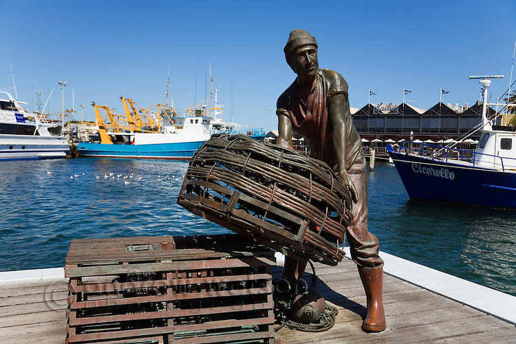 Sculpture of a lobster fisherman at Fishing Boat Harbour.  Fremantle, Western Australia, AUSTRALIA.
