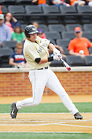 Matt Conway (25) of the Wake Forest Demon Deacons makes contact with the baseball against the Virginia Cavaliers at Wake Forest Baseball Park on May 17, 2014 in Winston-Salem, North Carolina.  The Demon Deacons defeated the Cavaliers 4-3.  (Brian Westerholt/Four Seam Images)