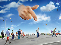Large hand in sky pointing to man standing out from the crowd