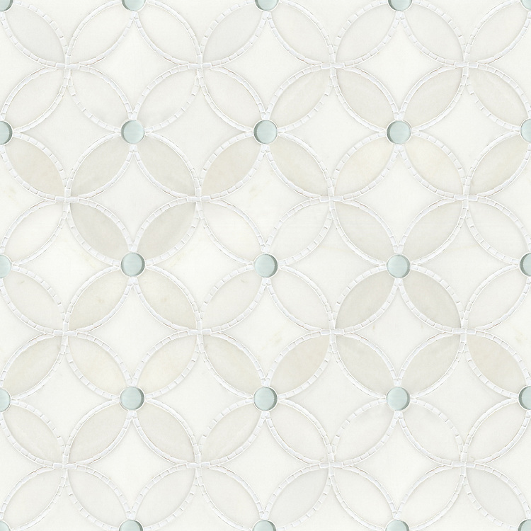 Esferitas,  a waterjet and hand-cut stone and Serenity glass and mosaic, shown in honed Paperwhite, tumbled Thassos, and Tropical White glass, is part of the Parterre Collection by New Ravenna.