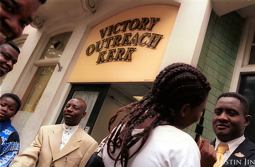 At the door of the Amsterdam branch of Victory Outreach, a controversial church that started in Los Angeles in 1967. It is spreading to Europe via the Netherlands. It builds its membership among junkies, prostitutes and criminals. ..Photo taken in the Netherlands in 2002. The picture is part of a photo and text documentary by Justin Jin. For more information, email justin@justinjin.com