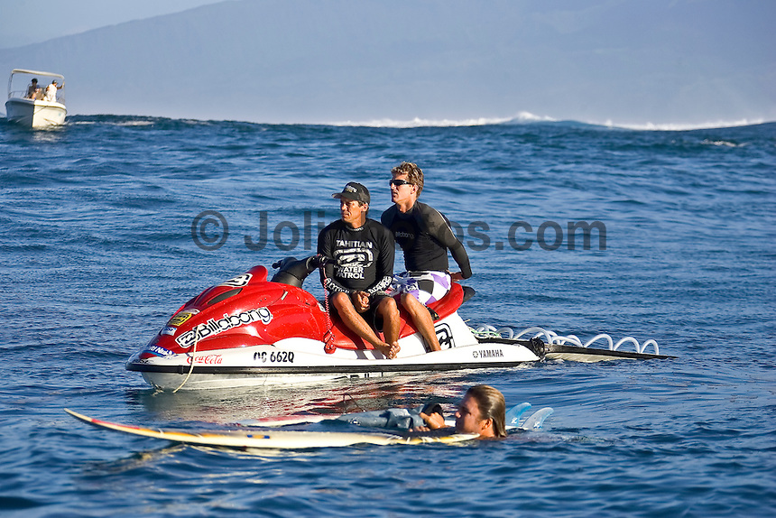Brock Little (HAW) and Andy Irons (HAW) surfing at Teahupoo, Tahiti during a two day swell session that included tow in and paddle in sessions featuring Top 45 surfers that became known as Maydayz. Photo: joliphotos.com