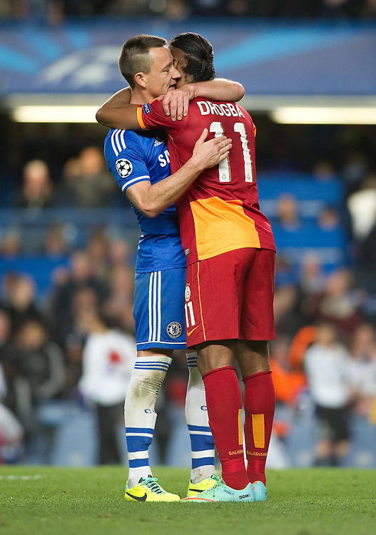 Chelsea's John Terry embraces Galatasaray's Didier Drogba at the end of the game<br /> <br /> Photo by Ashley Western/CameraSport<br /> <br /> Football - UEFA Champions League First Knockout Round 2nd Leg - Chelsea v Galatasaray - Tuesday 18th March 2014 - Stamford Bridge - London<br />  <br /> &copy; CameraSport - 43 Linden Ave. Countesthorpe. Leicester. England. LE8 5PG - Tel: +44 (0) 116 277 4147 - admin@camerasport.com - www.camerasport.com