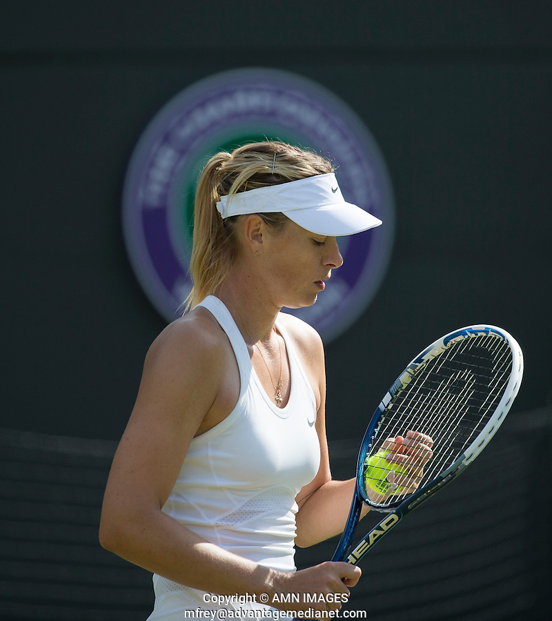 MARIA SHARAPOVA (RUS)<br /> <br /> The Championships Wimbledon 2014 - The All England Lawn Tennis Club -  London - UK -  ATP - ITF - WTA-2014  - Grand Slam - Great Britain -  24th June 2014. <br /> <br /> &copy; AMN IMAGES