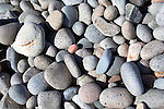 Seaside background of smooth rocks
