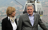 President of Germany Joachim Gauck ( L)  with his wife Daniela Schad while they visit the comuna nororiental Neighborhood In  Medellin, May 11, 2013. by Fredy Builes / VIEWpress