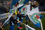 Blackburn Rovers 3 Shrewsbury Town 1, 14/01/2018. Ewood Park, League One. Young mascots flying flags in the home club's colours before Blackburn Rovers played Shrewsbury Town in a Sky Bet League One fixture at Ewood Park. Both team were in the top three in the division at the start of the game. Blackburn won the match by 3 goals to 1, watched by a crowd of 13,579. Photo by Colin McPherson.