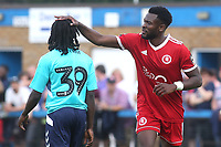 Anthony Cook of Welling United rests his hand on the head of Charlton's Abraham Odoh during Welling United vs Charlton Athletic, Friendly Match Football at the Park View Road Ground on 13th July 2019