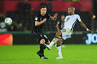 Jason Pearce of Charlton Athletic under pressure from Andre Ayew of Swansea City during the Sky Bet Championship match between Swansea City and Charlton Athletic at the Liberty Stadium in Swansea, Wales, UK.  Thursday 02 January 2020