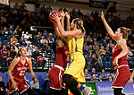 BROOKINGS, SD - DECEMBER 6: Macy Miller #12 from South Dakota State takes the ball to the basket against Shaina Pellington #14 from Oklahoma during their game Wednesday night at Frost Arena in Brookings. (Photo by Dave Eggen/Inertia)