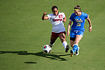 ORLANDO, FL - DECEMBER 03: Kiara Pickett #25 of Stanford University and Zoey Goralski #26 of UCLA battle for the ball during the Division I Women's Soccer Championship held at Orlando City SC Stadium on December 3, 2017 in Orlando, Florida. Stanford defeated UCLA 3-2 for the national title. (Photo by Jamie Schwaberow/NCAA Photos via Getty Images)