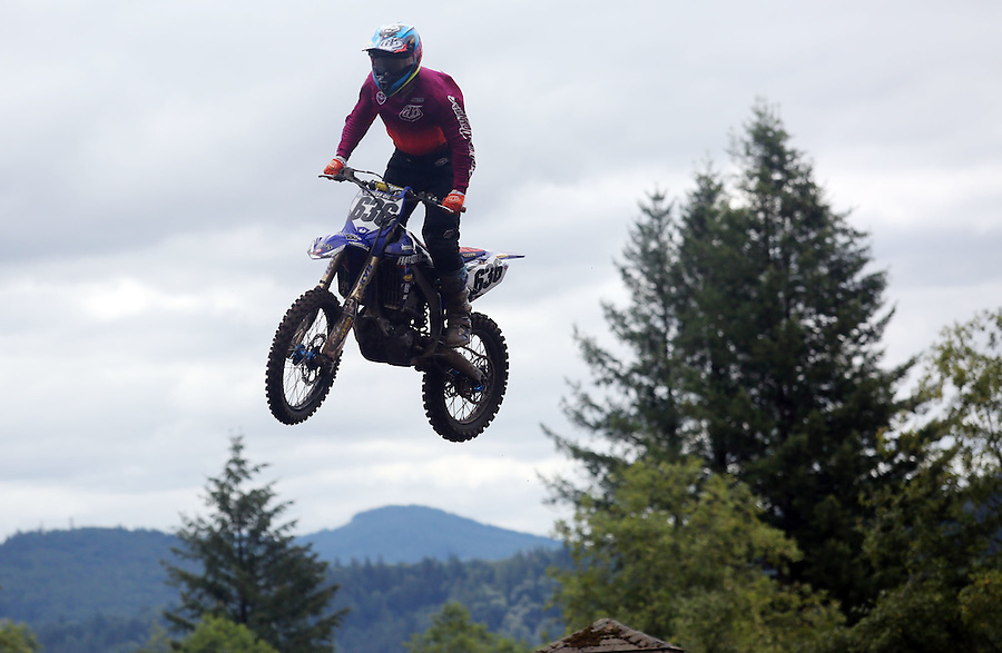 A riders is airborne in the 450cc race in the Washougal MX National in Washougal Saturday July 23, 2016. D(Photo by Natalie Behring/ for the The Columbian)
