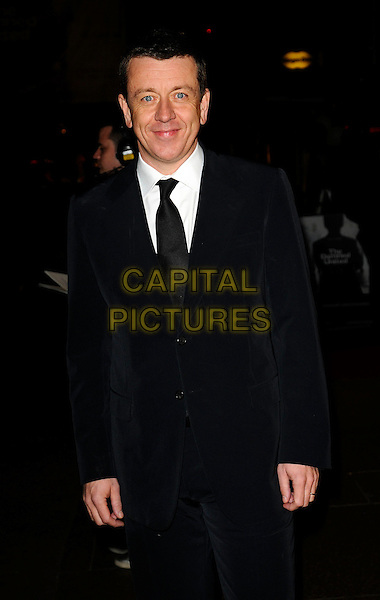 "PETER MORGAN, screenwriter .World Premiere of ""The Damned United"" at the Vue West End, Leicester Square, London, England..March 18th 2009.half 3/4 length black suit .CAP/CAN.©Can Nguyen/Capital Pictures."