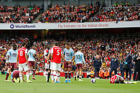Players converge with Anwar El Ghazi of Aston Villa and<br /> Ainsley Maitland-Niles of Arsenal both down during the Premier League match between Arsenal and Aston Villa at the Emirates Stadium, London, England on 22 September 2019. Photo by Carlton Myrie / PRiME Media Images.