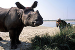 Deddeda takes a photo of Beauty, the resident rhino, in Sauraha, Nepal, near Chitwan National Park.