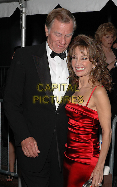 SUSAN LUCCI & GUEST.Arrivals at the 2005 Daytime Emmys at Radio City Music Hall in New York City, USA, 20 May 2005..half length red dress.Ref: ADM.www.capitalpictures.com.sales@capitalpictures.com.©Patti Ouderkirk/AdMedia/Capital Pictures.