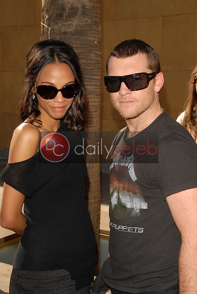 Zoe Saldana and Sam Worthington<br /> at the induction ceremony for James Cameron into the Hollywood Walk of Fame, Hollywood Blvd, Hollywood, CA.  12-18-09<br /> David Edwards/Dailyceleb.com 818-249-4998