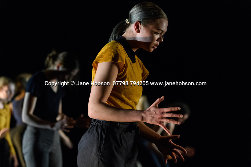 "Leeds, UK. 19.03.2019. First and Third Year students of BA (Hons) Dance (Contemporary), at the Northern School of Contemporary Dance, present work as part of FLOCK FEST, in the Riley Theatre. This piece is: ""Here Beneath the Stars I'm Mending"" by choreographer Anna Williams. The dancers are: Var Bech, George Bishop, Lisa Chearles, Chiara de Craene, Kieron Donohoe-Faller, Grace Ford, Alex Gosmore, Clara Grosjean, Angharad Jones-Young, Ting Lee, Zara Lee, Kamal Macdonald, Maya Marsh, Lexie McPherson, Martha Pigg, Cushla Sutherland, Alfie Theobald, Sophie Thomas, Tammy Tsang, Brannon Yau. Photograph © Jane Hobson."