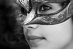 fantasy black and white image of a young woman wearing a mask