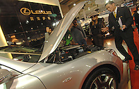 Salesmen talk to potetial buyers of a Lexus at the Luxury Goods Fair in Guangzhou, China..16 Dec 2006