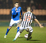 St Mirren v St Johnstone...25.03.14    SPFL<br /> Gary Miller is closed down by Gregg Wylde<br /> Picture by Graeme Hart.<br /> Copyright Perthshire Picture Agency<br /> Tel: 01738 623350  Mobile: 07990 594431