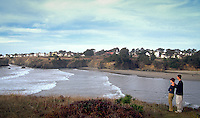 Enjoying a view of the village of Mendocino from the Headlands State Park, across Mendocino Bay, Northern CA.  CD scan from 35mm slide film.  Model released.. © John Birchard