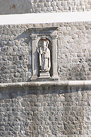 Carved stone statue of the patron saint St Blaise above and guarding the Vrata Pile city gate Dubrovnik, old city. Dalmatian Coast, Croatia, Europe.