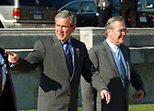 United States President George W. Bush is escorted to Marine One by United States Secretary of Defense Donald Rumsfeld as he departs the Pentagon in Arlington, Virginia on November 24, 2003 following his signing H.R. 1588, the National Defense Authorization Act of Fiscal Year 2004.<br /> Credit: Ron Sachs / CNP