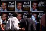 People check out some political posters of past president Carlos Menem in the Central Banking District.